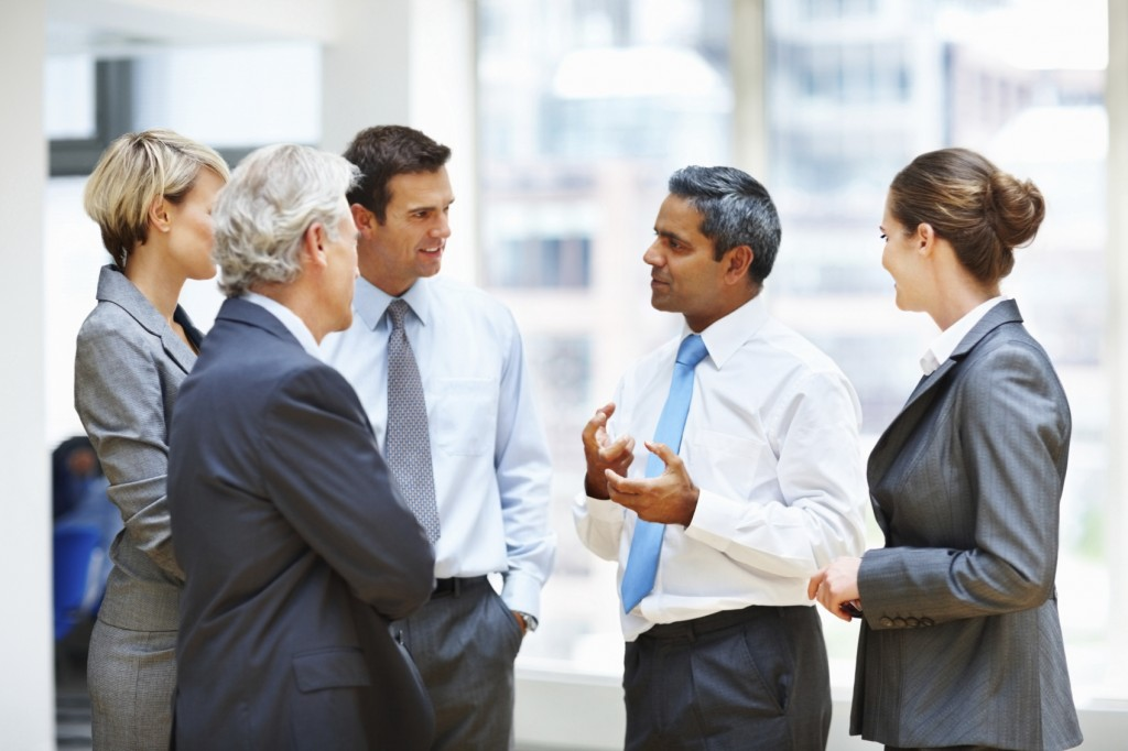 Portrait of a business people discussing something in office